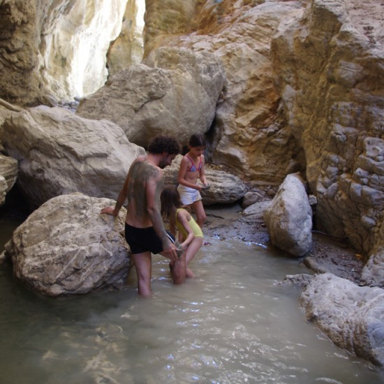 "Kids and grown-ups climb up the Fonissa (=""murderess"") gorge"