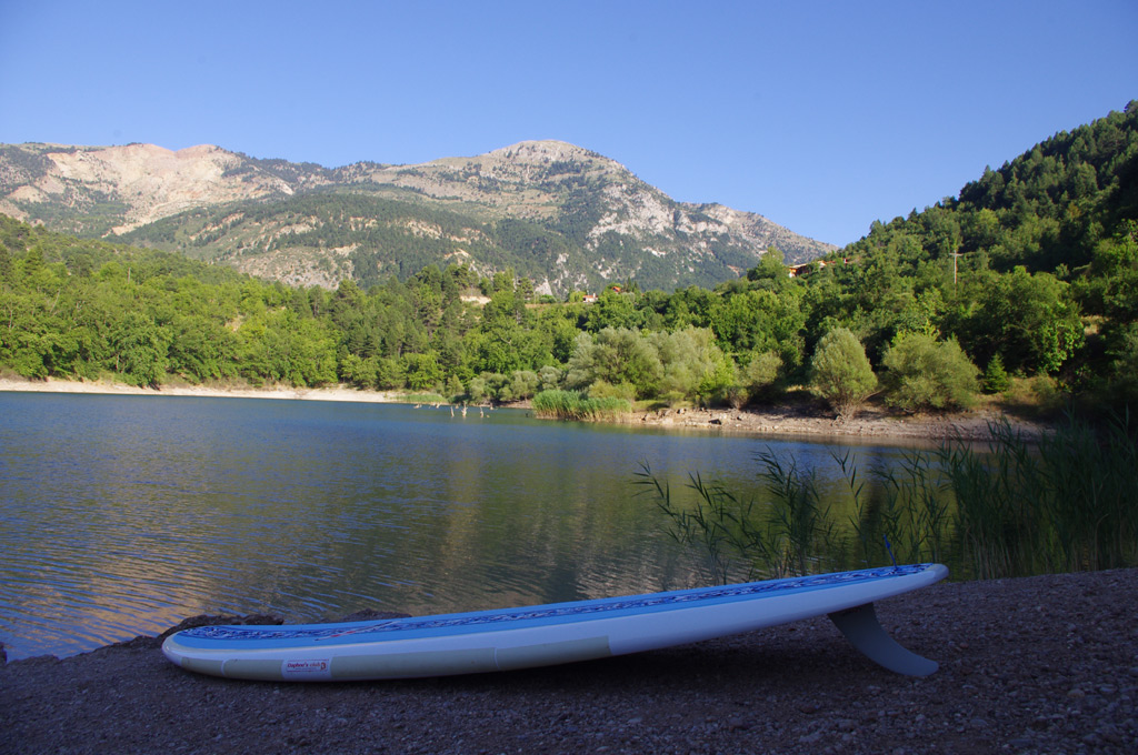 Swim and SUP in a mountain lake
